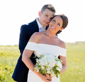 Married couple smiling during their portrait session at Bartlett Farms Nantucket