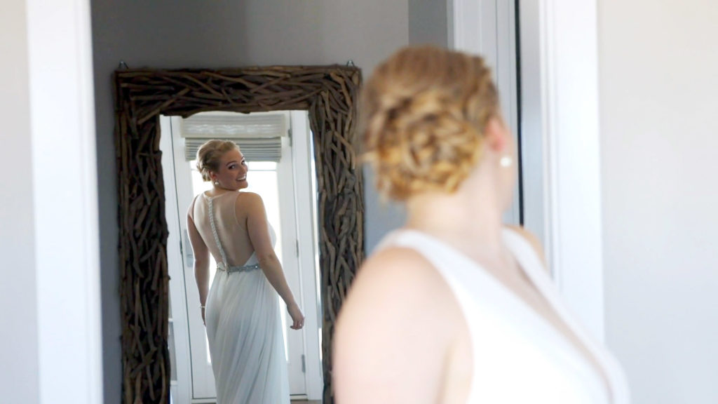 Wychmere Bride looking at her dress in a full length mirror