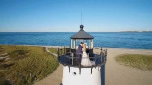 Bride and Groom kissing on top of Edgartown Lighthouse filmed by Harborview Studios