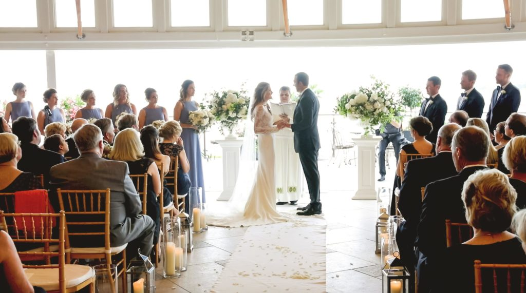 Bride and groom exchanging vows at Wequassett Resort and Golf Club on Cape Cod