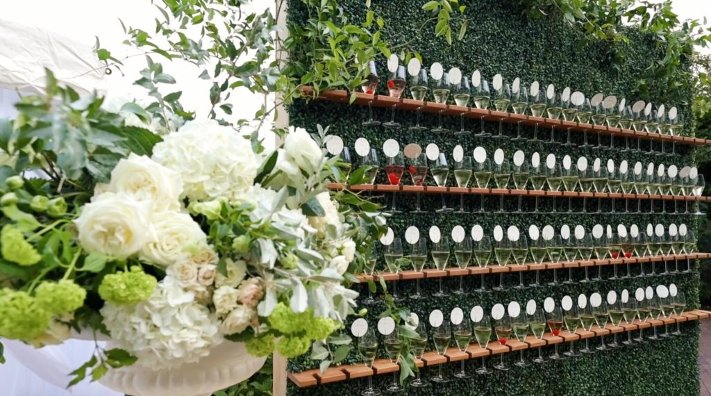 Elegant custom champagne wall doubles at table seating arrangement at Wequassett Resort and Golf Club on Cape Cod