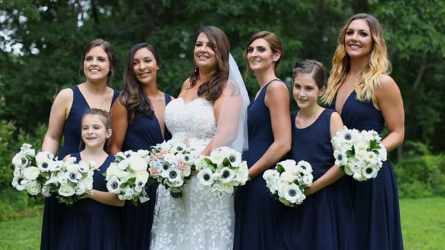 Popponesset Inn bride with bridesmaids during photo session