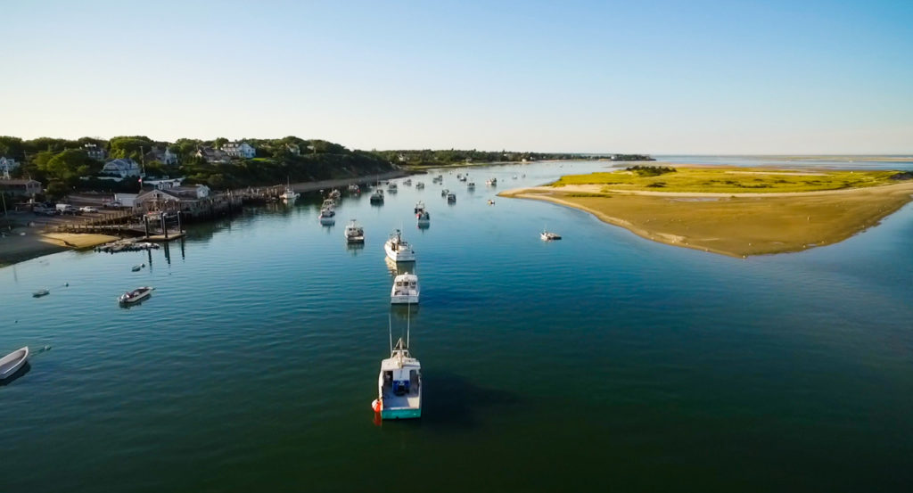 View of boats on Atlantic Ocean in front of Chatham Bars Inn on Cape Cod.