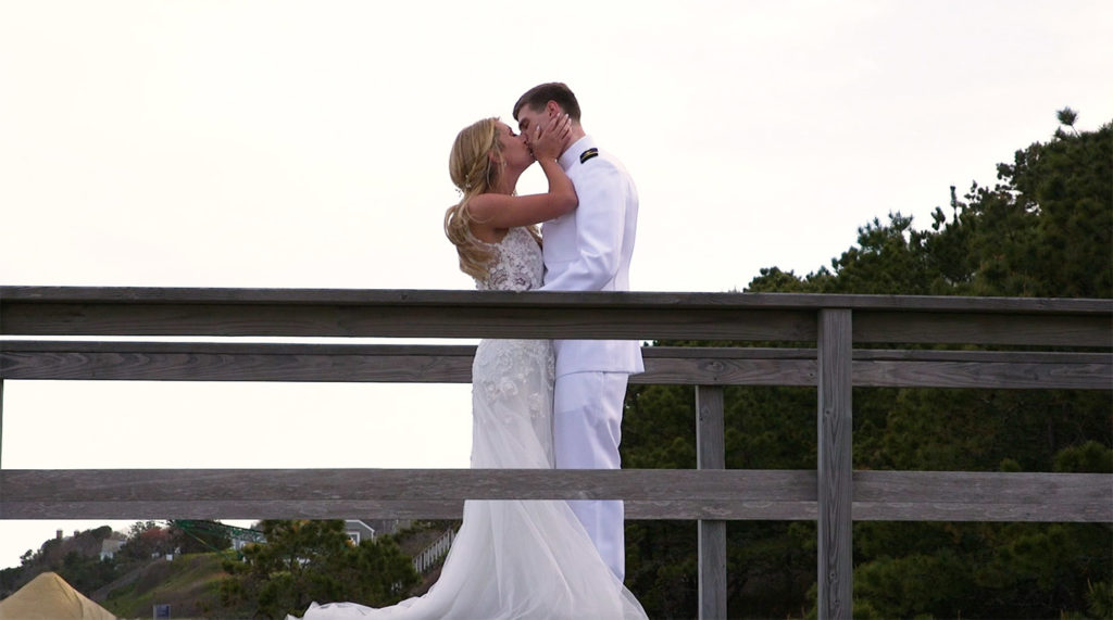 Bride and Groom kissing on Cape Cod boardwalk
